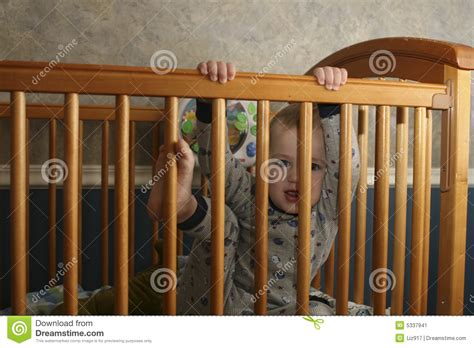 toddler climbing out of crib stock image image 5337941