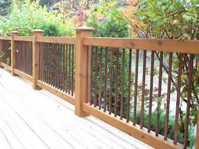 cedar deck railing with iron view more deck railing ideas http awoodrailing com 2014 11 16