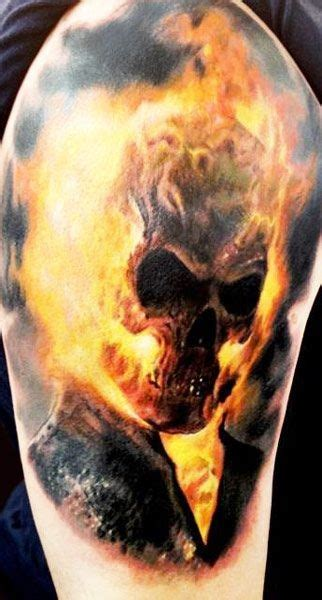cool natural looking and colored ghost rider tattoo on
