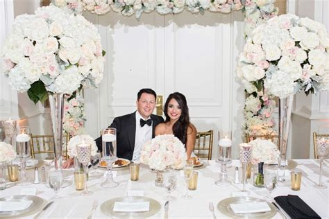 Newlywed Home Decor couples photos bride and groom smiling at head table