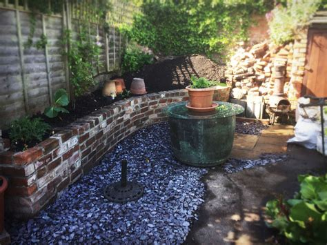 Retaining Wall Planters by Reclaimed Brick Planter Retaining Wall Blue Slate Path