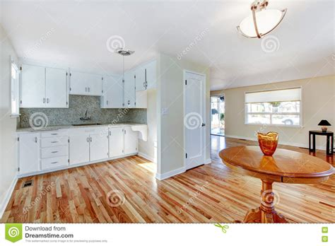 white kitchen cabinets with hardwood floors white kitchen cabinets with light tone hardwood floor