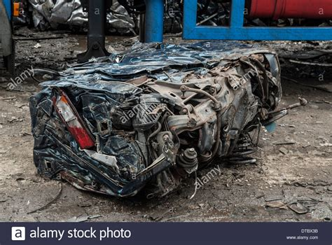 crushed by crushed cars in scrap yard uk stock photo 66644799 alamy