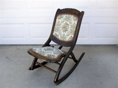 antique mahogany folding rocking chair with floral patterned