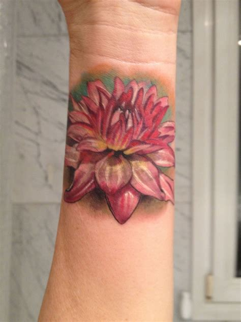 laura tattoo dahlia flower by juan madrid spain