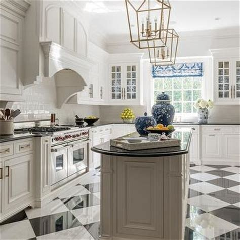 white and gold kitchen features white cabinets adorned white and gold kitchen with black accents transitional kitchen