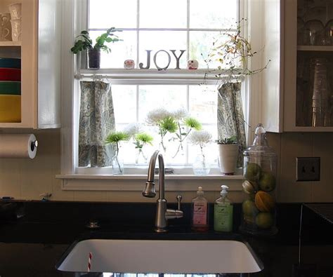 kitchen window shelf ideas kitchen sink curtains with the shelf so also hang up two paper towel holders