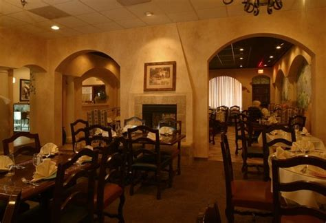 this is the dining room with a cozy fireplace picture of
