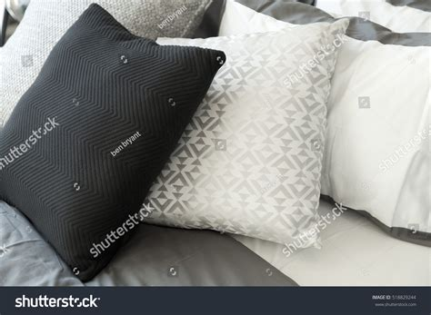 black pillows for bed black and white pillows on bed stock photo 518829244