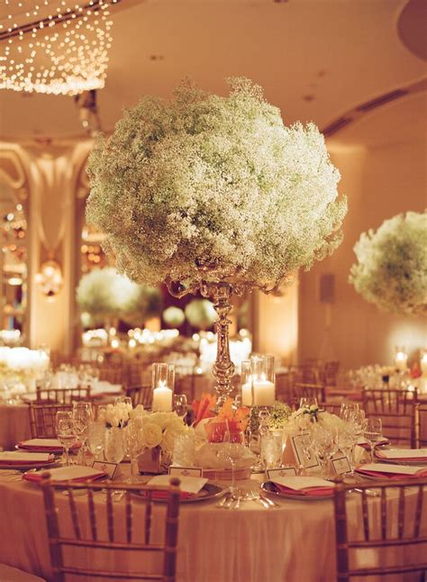 overflowing babys breath candelabra centerpiece