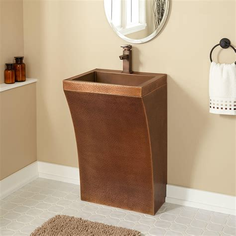 curved hammered copper pedestal sink bathroom