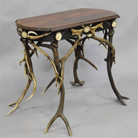 small antler side table with great decorations circa 1890