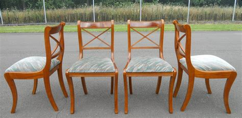sold set of four sabre leg yew dining chairs