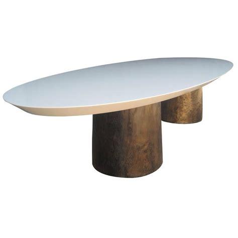 benone pedestal oval dining table cast bronze bases