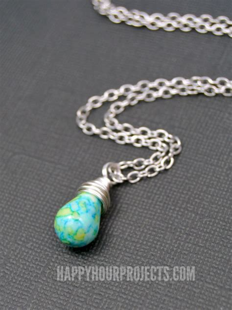 how to wire wrap a bead how to make a wire wrapped bead pendant happy hour projects