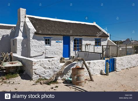 Cape Cottages by White Washed Reed Thatched Roof Cottages In Kassiesbaai