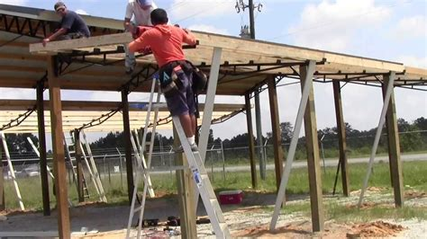install lean tos    steel truss pole barn