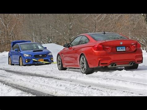wrx sti vs bmw m4 snow tow (summer tires awd vs winter