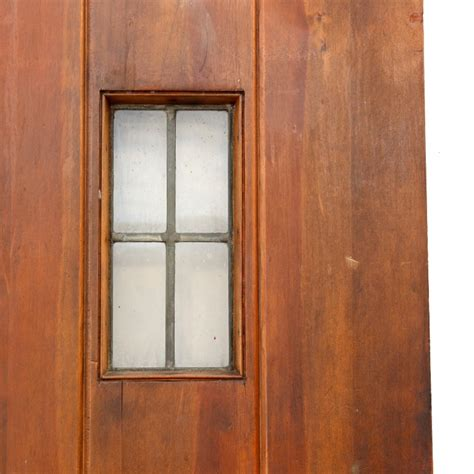 unique antique exterior 36 plank door with small leaded