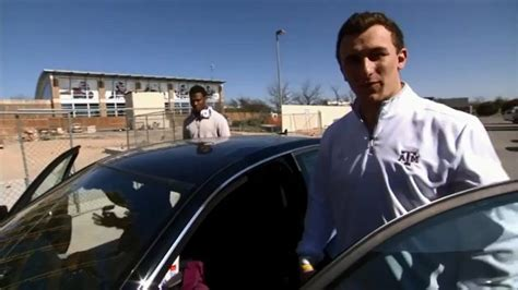 johnny manziel drives away in a pretty sweet ride for an