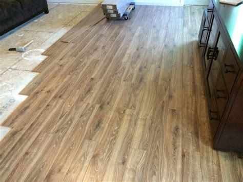 floor coming along lowe s allen roth driftwood oak laminate in my ryan home palermo model