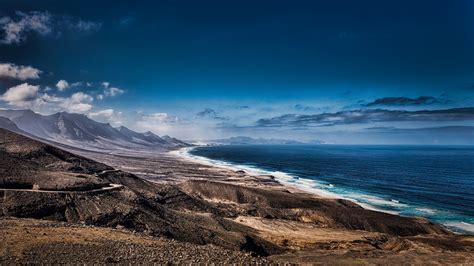 spanish nature of photographs 0714865702 тапети слънчева светлина пейзаж море рок природа бряг небе облаци плаж изгрев