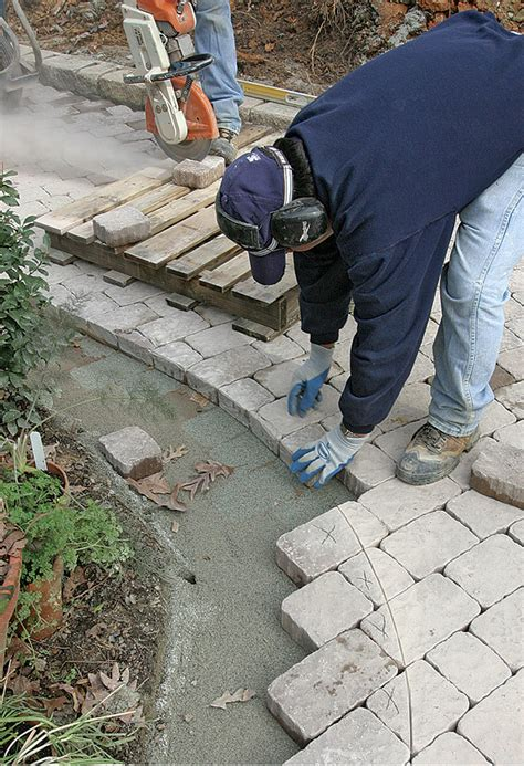 cutting patio pavers a concrete paver patio from the bottom up homebuilding