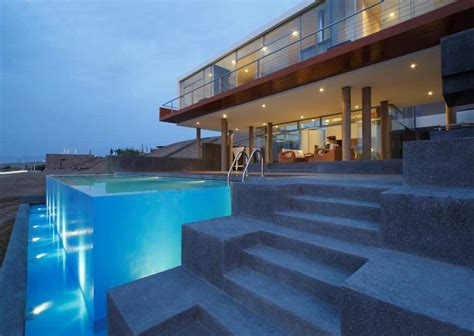 stunning ultramodern beach house  overflowing pool