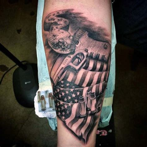 gun tattoo upper arm mens glock with american flag and hollow point bullet