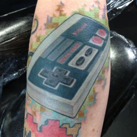 nintendo controller tattoo nes controller by jake betts