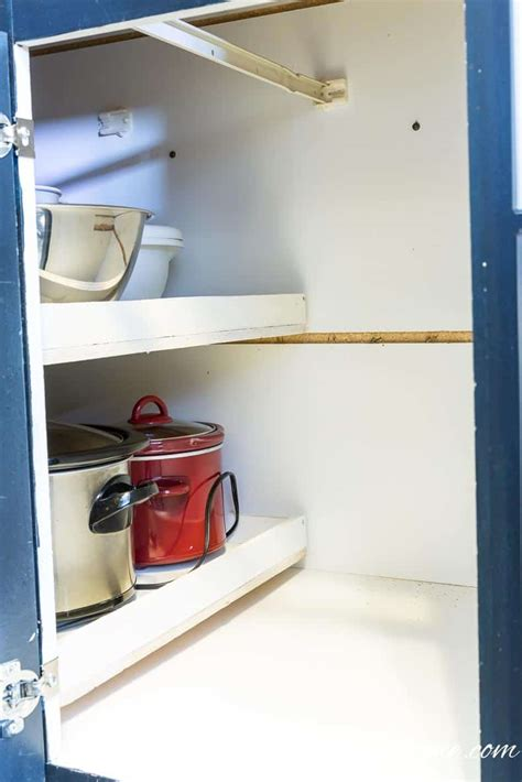 blind cabinet pull out shelves how to build pull out shelves for a blind corner cabinet