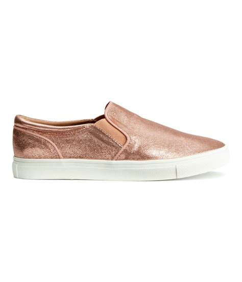 gold slip on sneakers treat yourself to some gold slip on shoes h m
