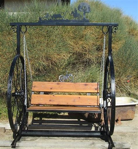 wagon wheel porch swing garden swing hand made w 100 yr old hay rake wheels steel