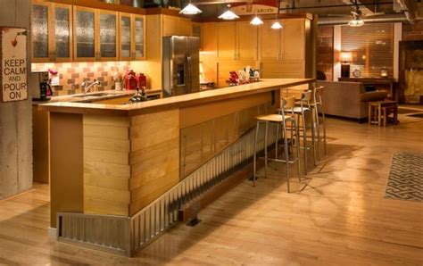 kitchen island with bar top kitchen island of a downtown loft redesigned as an
