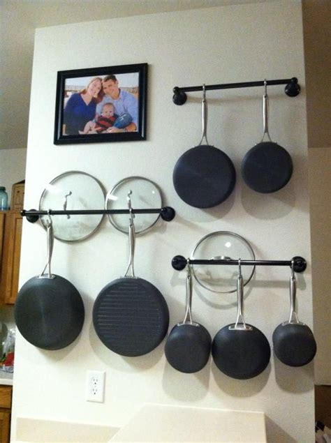 hanging pot rack in cabinet how to choose the right rack for hanging pots and pans