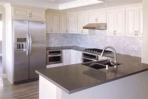 antique white kitchen cabinets with quartz countertops antique white kitchen cabinet with grey quartz countertop
