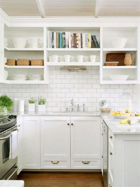 Bright Small Kicthen With Marble Countertop Wooden Backsplash For White Kitchen