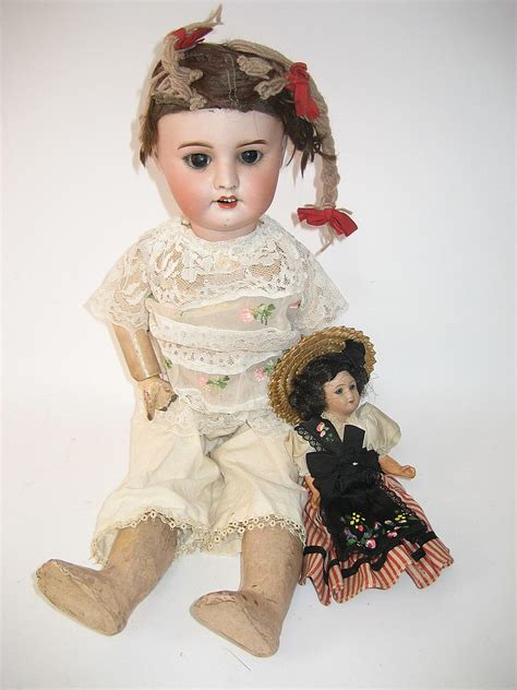 bisque doll with glass an sfbj bisque doll with brown glass