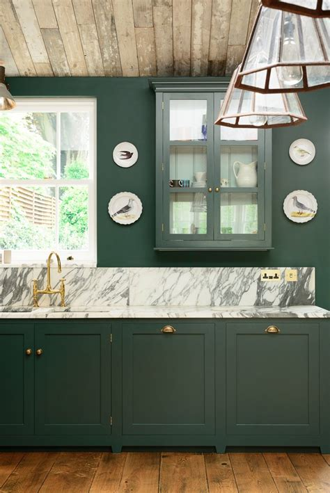 green kitchen is perfect choice for a kitchen wall and pop of color in the kitchen greige design