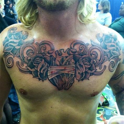 heart tattoos on chest for men grey ink and flowers chest for