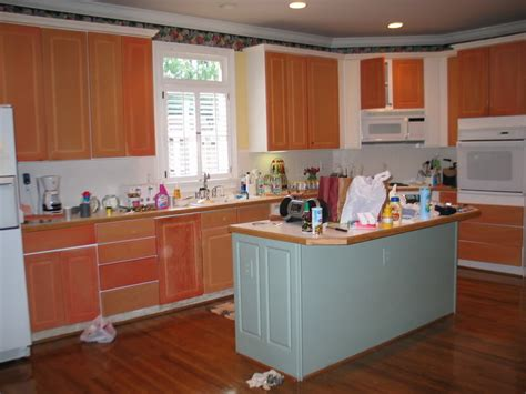 painting thermofoil kitchen cabinets painting thermofoil cabinets with sloan part 1 removing thermofoil from cabinets with heat gun and