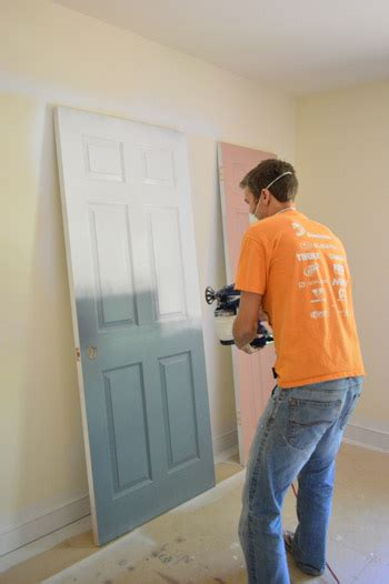How To Spray Paint Interior Doors by Priming And Painting Our Trim And Doors With A Paint