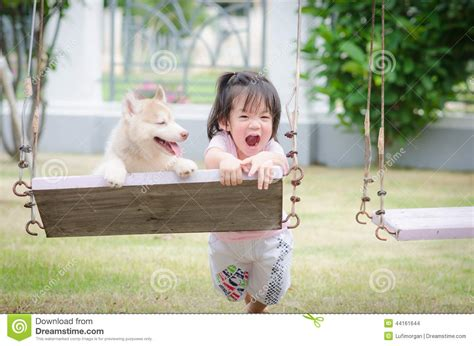 baby on swing asian baby baby on swing with puppy stock photo image