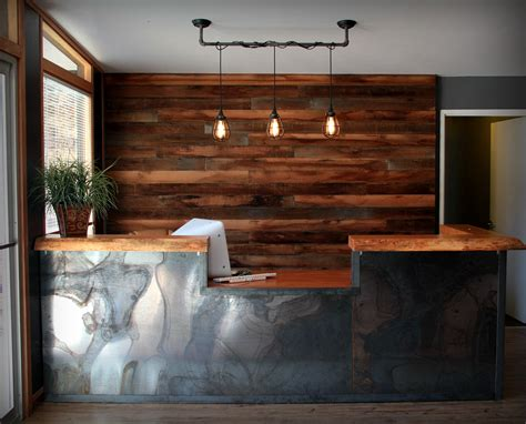 industrial reception desk rustic wood wall industrial pipe pendant light reclaimed