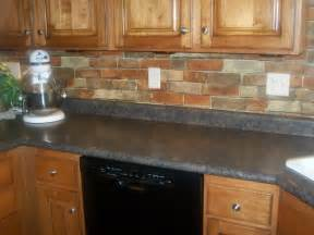 brick backsplash for narrow kitchen design with oak