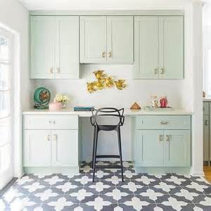 mint green kitchen cabinets with brass pulls