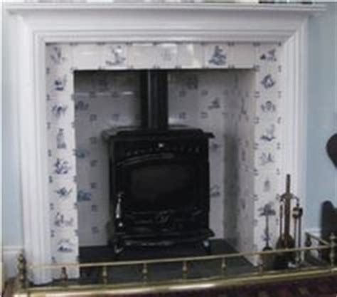 Dining Room Fireplace Tiles Delft Tiles Around A Cozy Fireplace For The Home