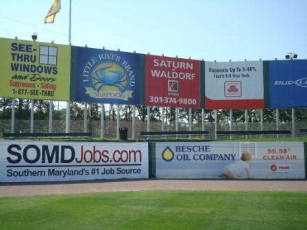 school banners and fence mesh give chain link new purpose