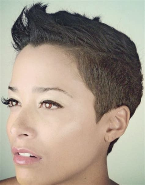 very short ladies hair with weight on crown clippered sides and nape graduated lenth from crown