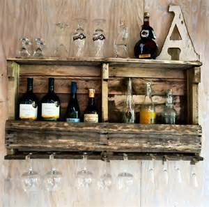 wine rack made from wood pallet with glass holder